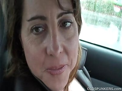 Sexy MILF is so horny she plays with her pussy in public